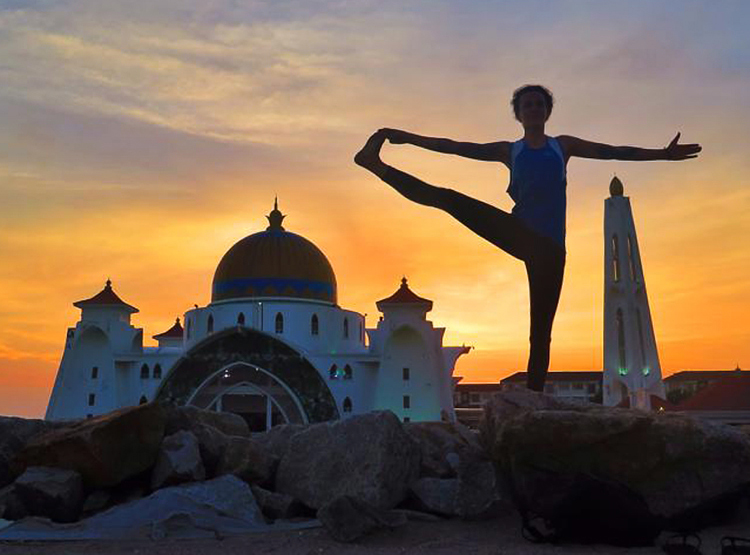Yoga, sunset and mosque. Malacca, Malaysia